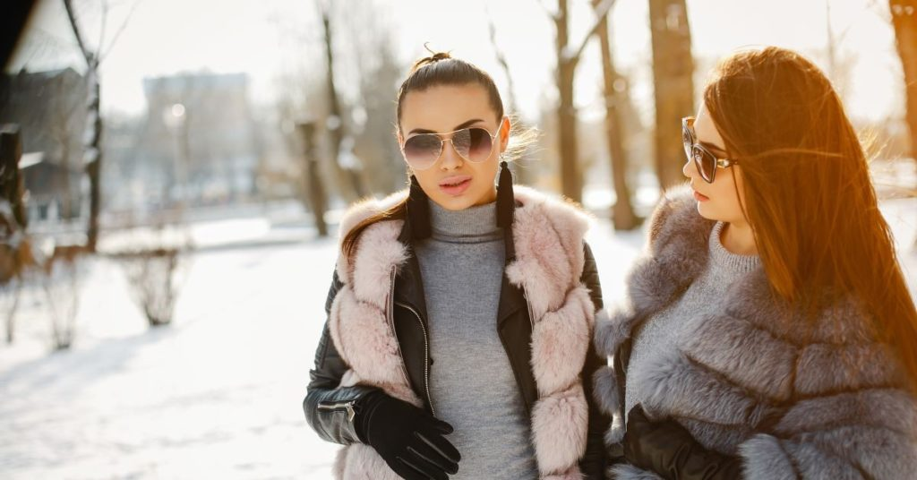 women in coats in the winter